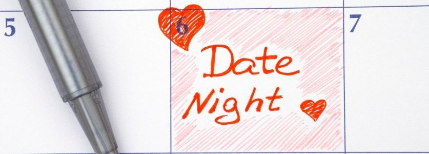 Calendar with the date circled saying date nigh with a red heart