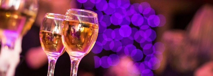 wine glasses on bar at nightclub