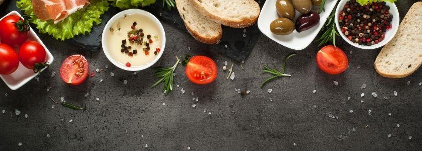 array of Mediterranean foods on dark table