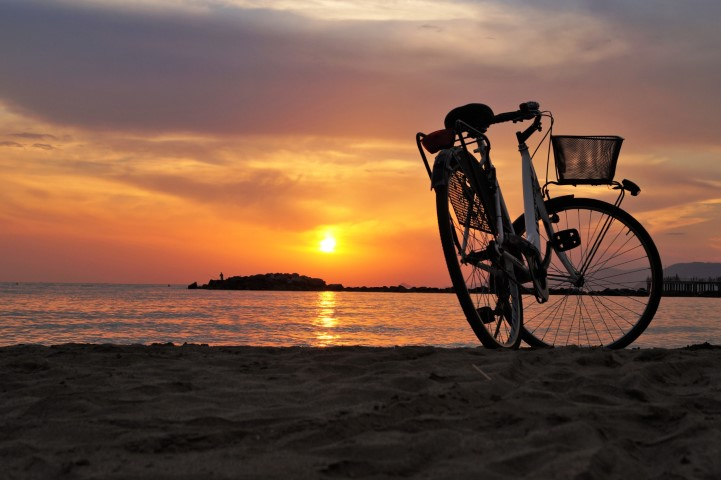 bikes on kakaako beach at sunset