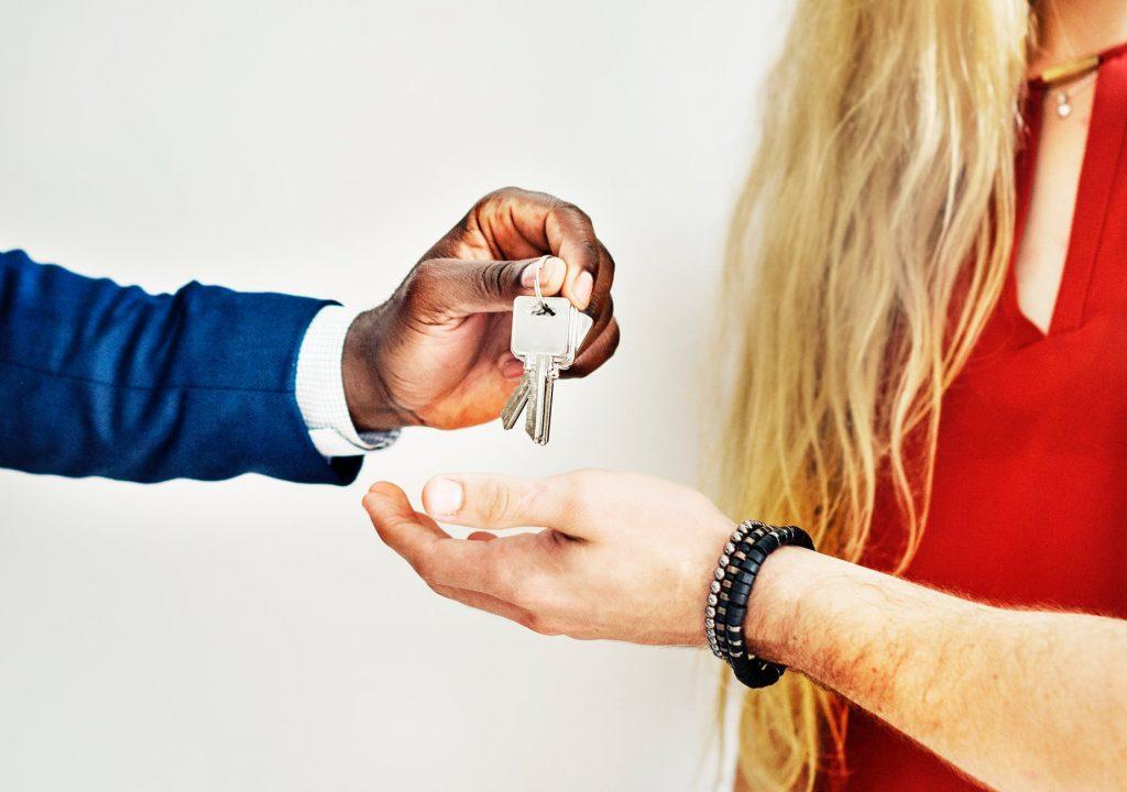 People Exchanging Keys