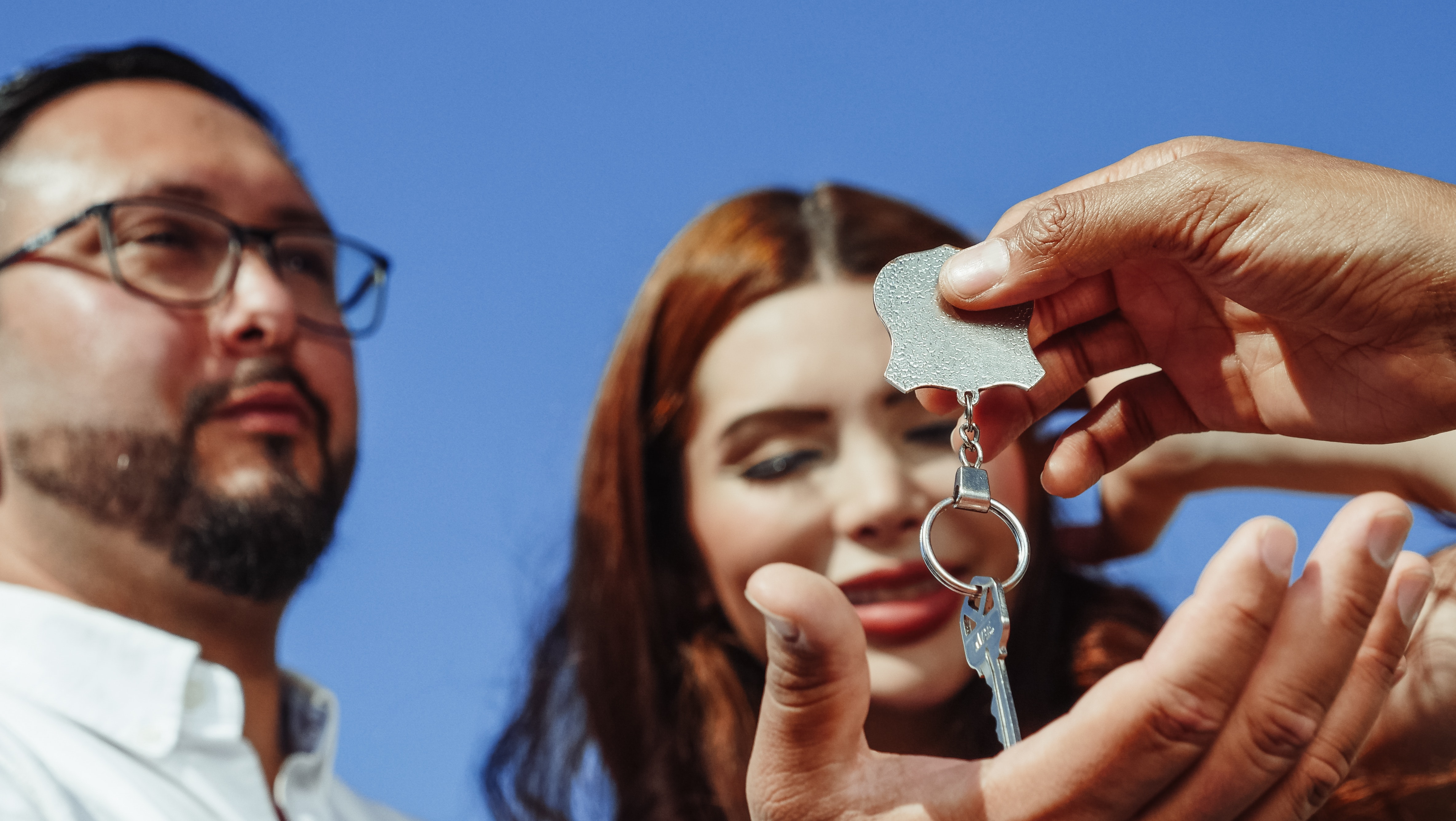 Home Buyers Receiving Keys To Their New House