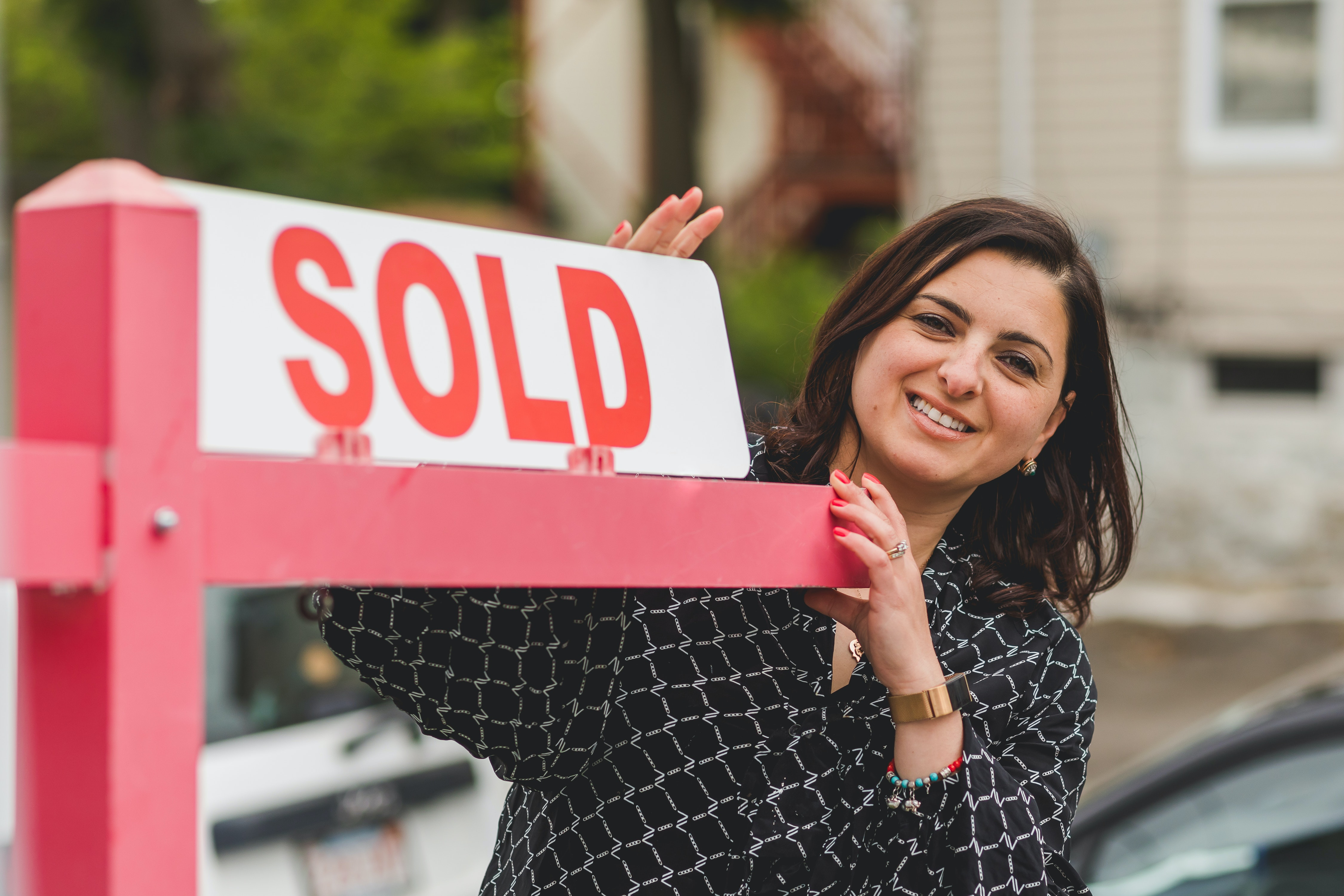 Realtor With Sold Sign