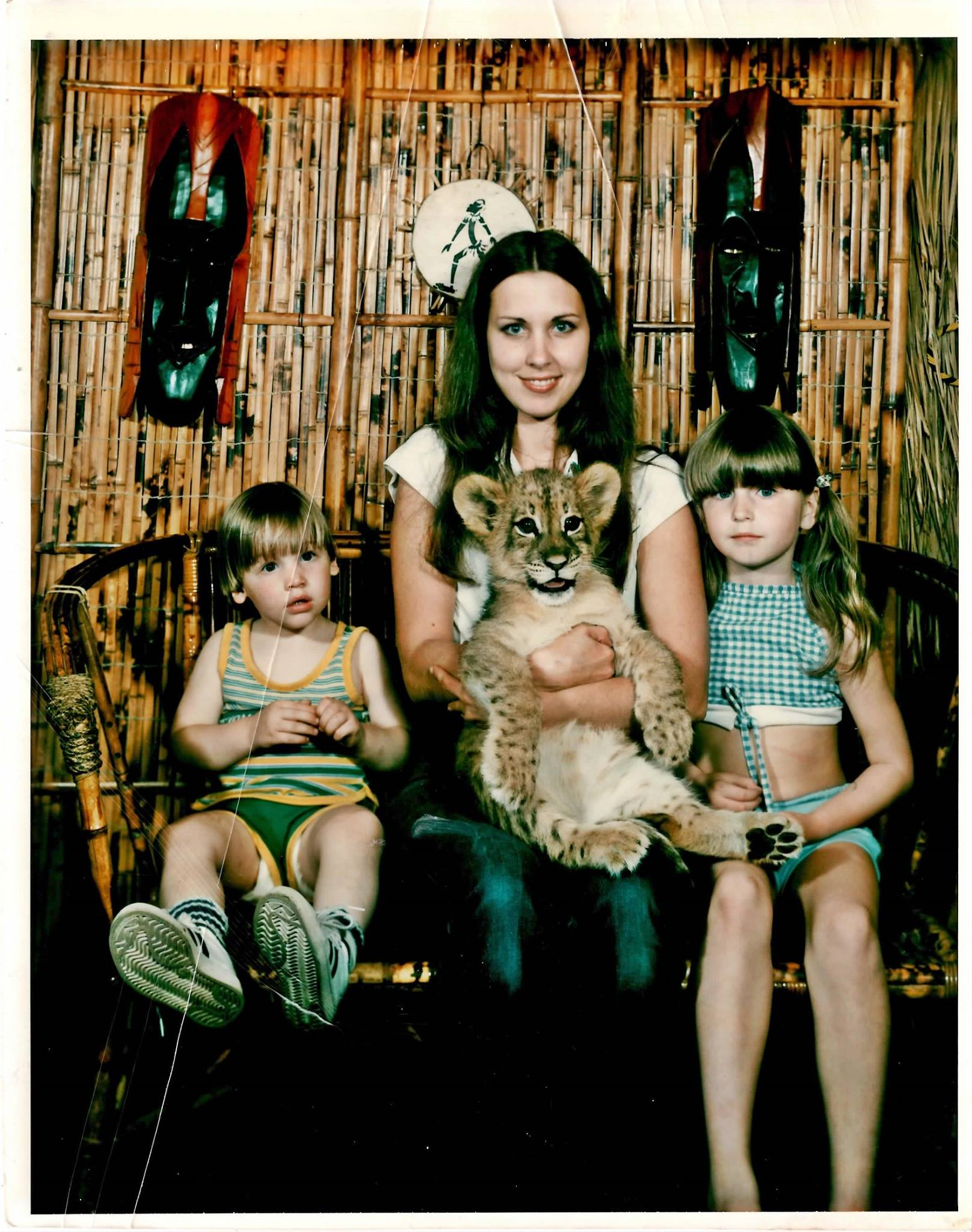 judy orr and kids with lion cub at safari jungle in florida