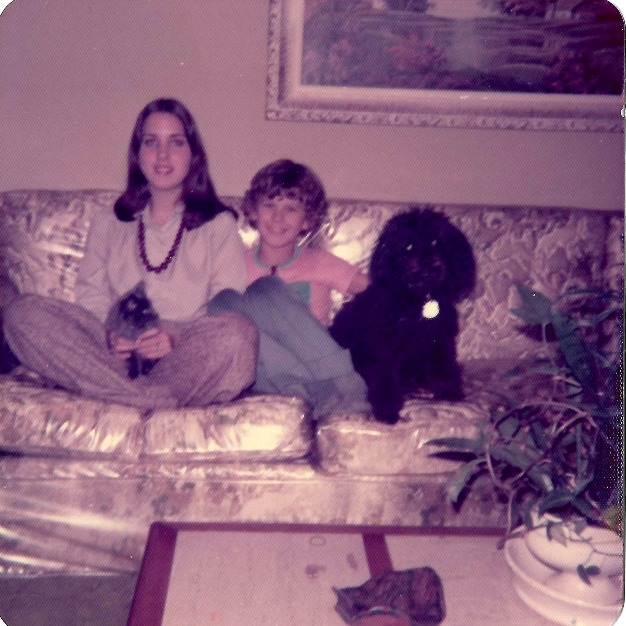 family on plastic covered couch before the couch made it to AZ