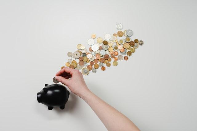 coins next to a piggy bank