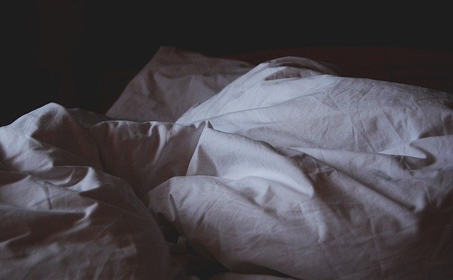 dark bed sheets in a scottsdale home