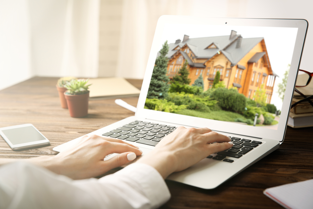 woman searching for a Scottsdale home for sale on her laptop