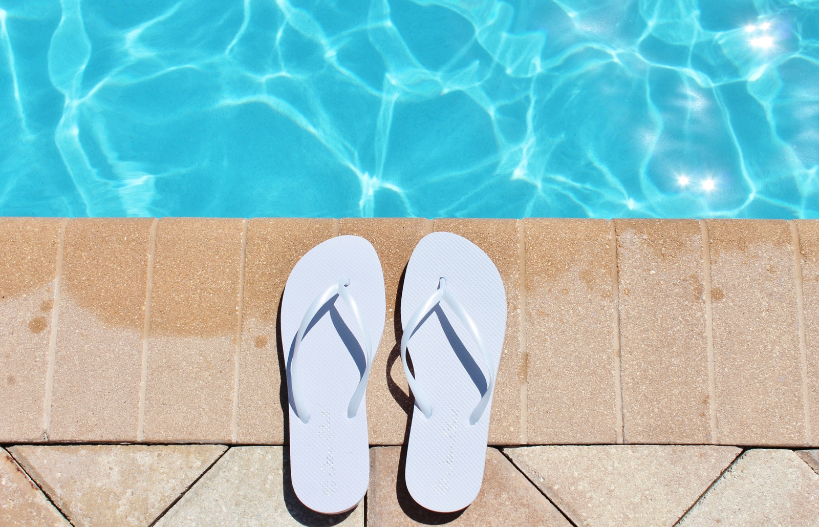 scottsdale home inground pool with flipflops