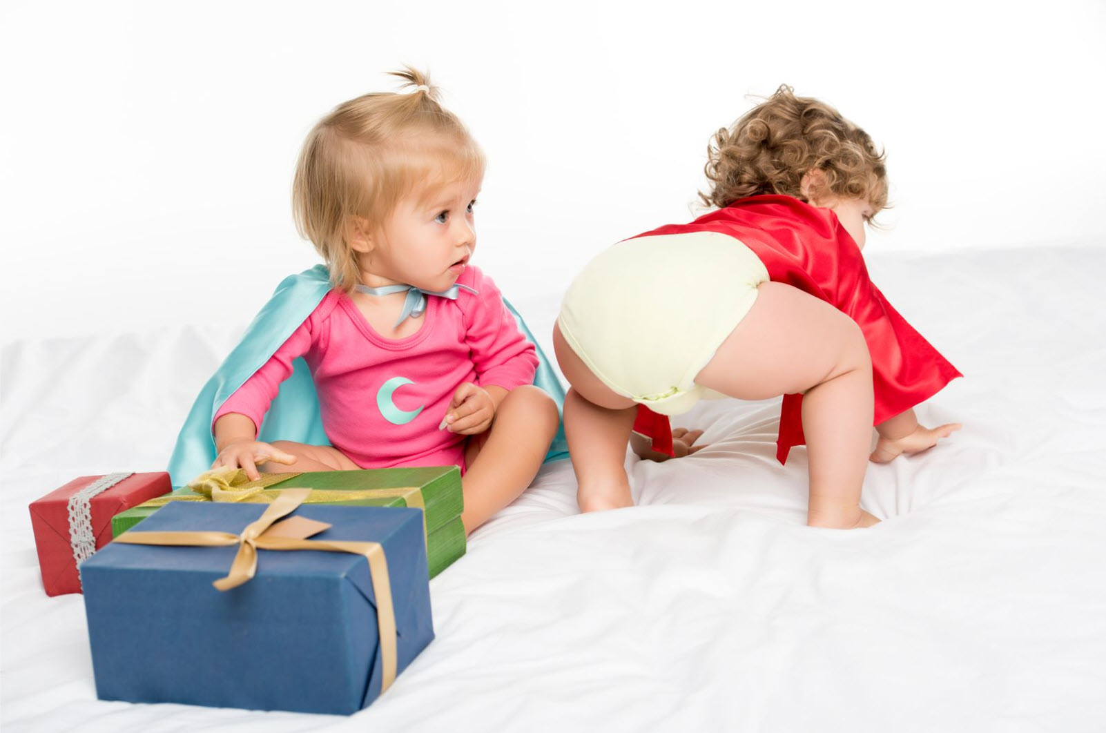 toddlers at the holidays with presents