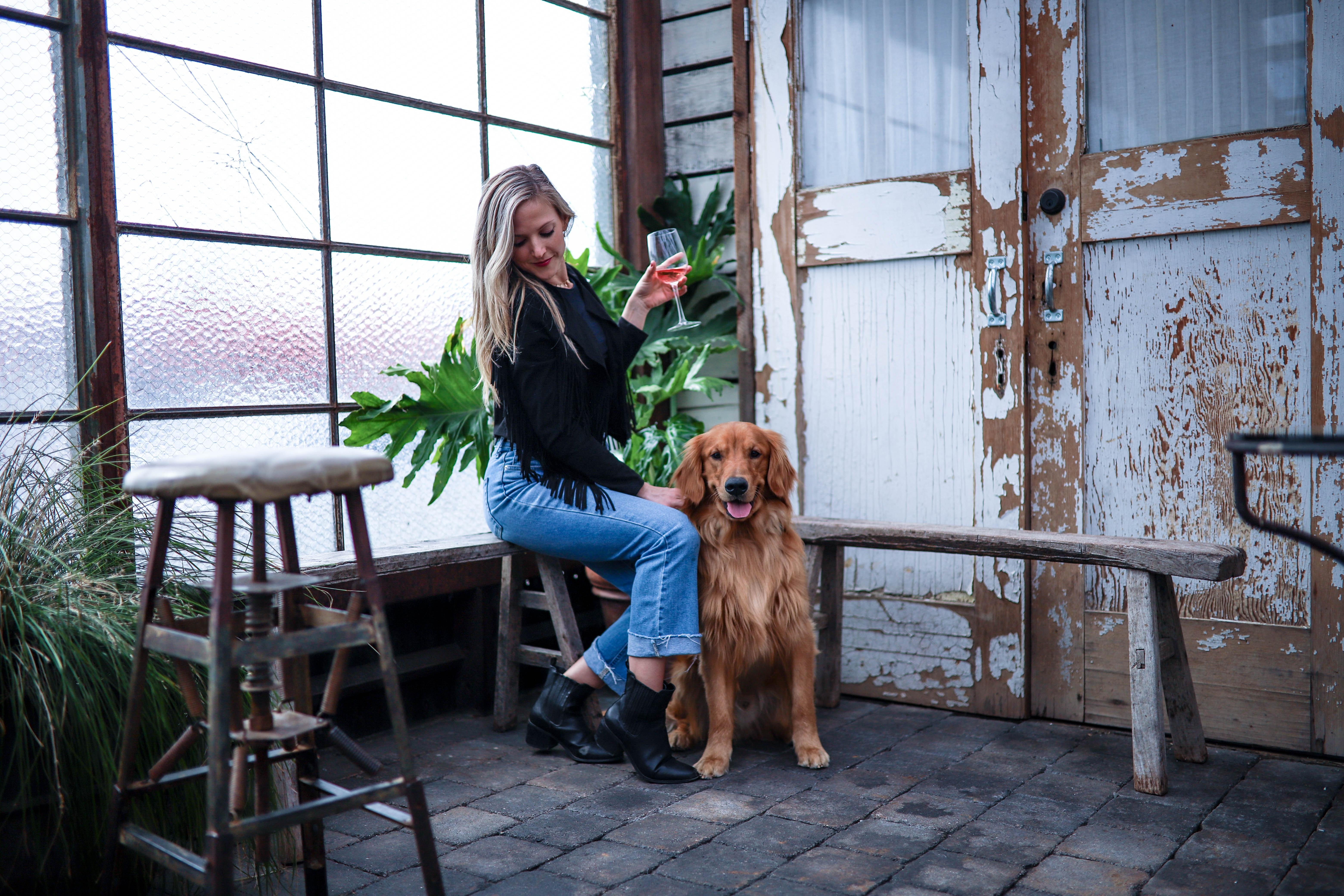 girl with dog at bar