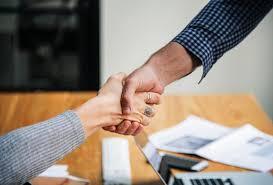 larsonsold.com agents shaking hands