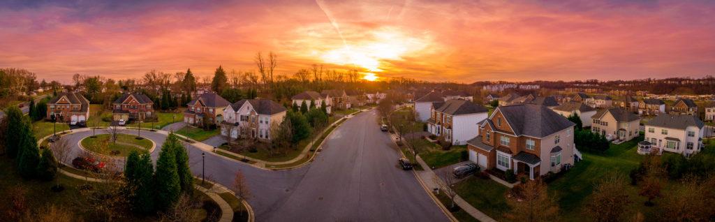An overhead shot of a beautiful neighborhood with the sun setting