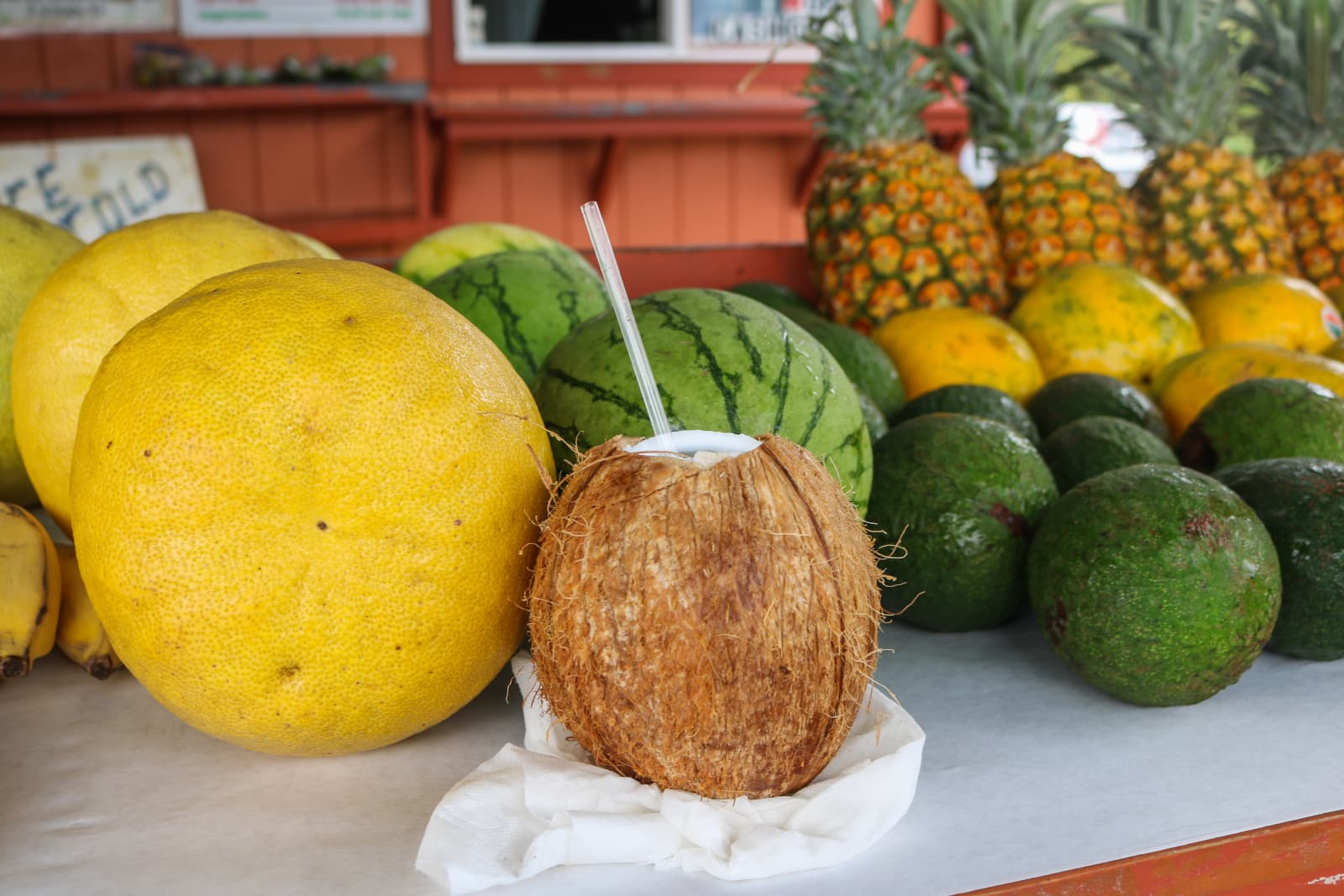 Fresh Coconuts On Counter With Straw
