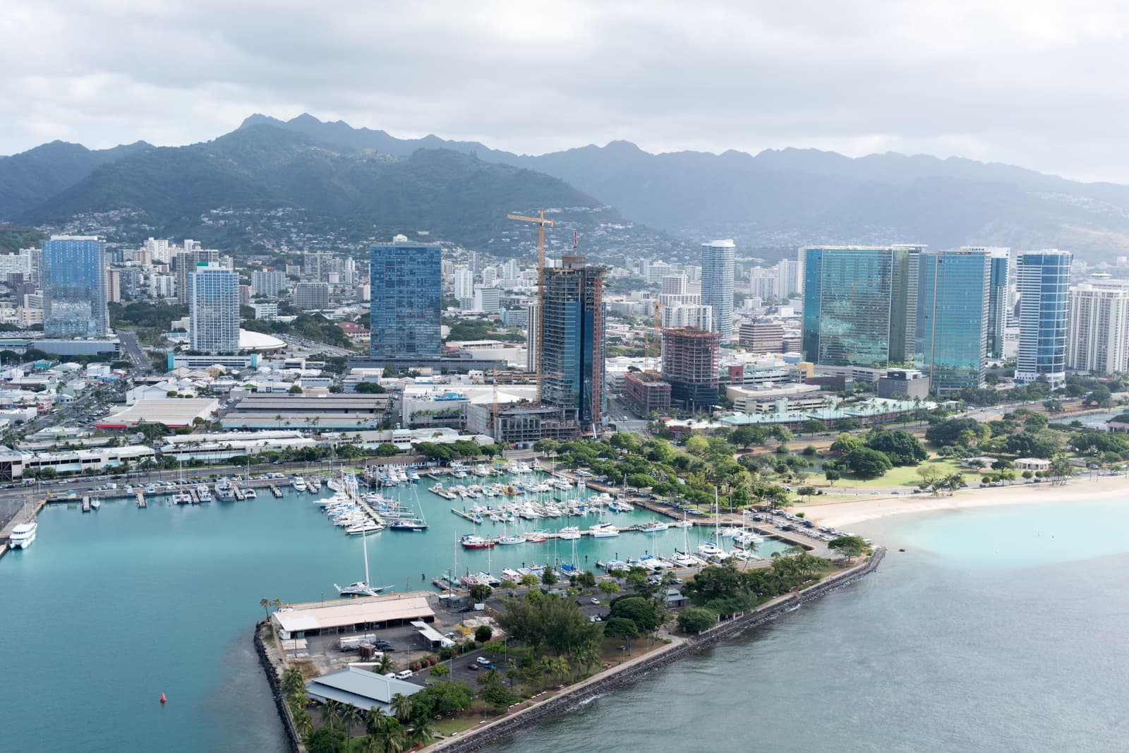 Aerial view of Honolulu with condo tower under construction