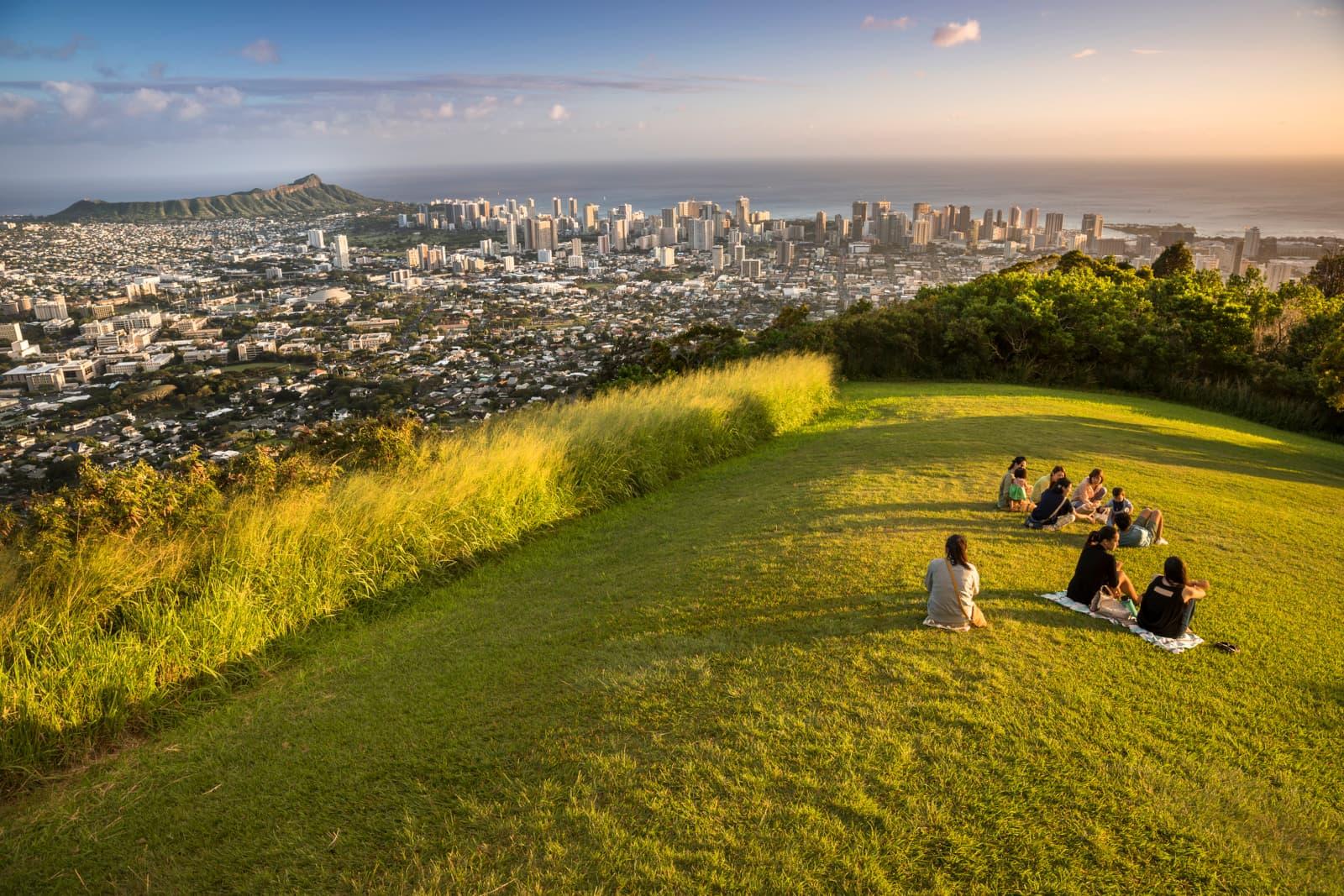 People relaxing on a hilltop in Honolulu