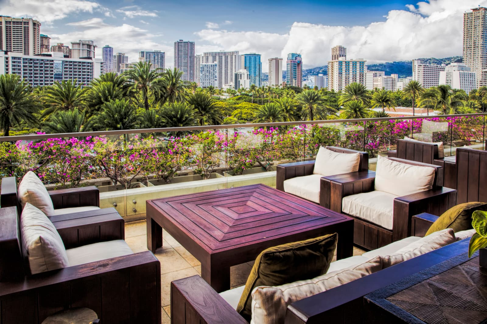Coffee table and chairs in a lounge area looking over Honolulu
