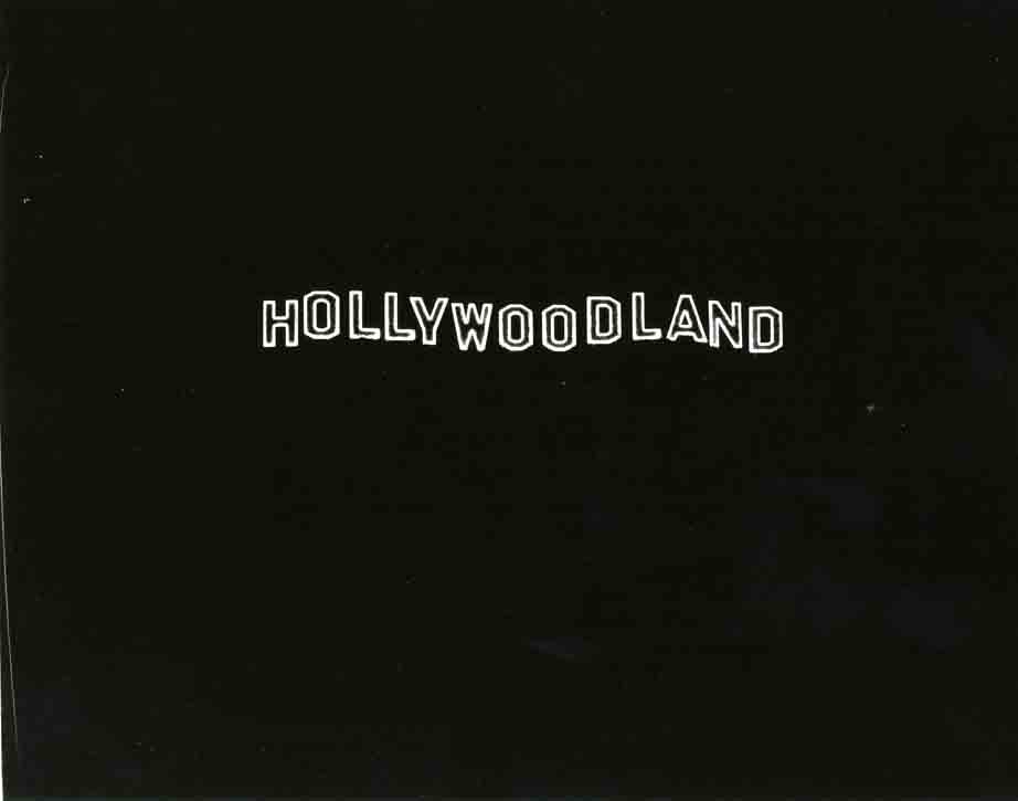 Hollywood land sign at night