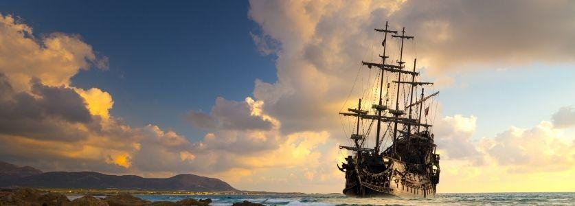 pirate ship on sunset horizon