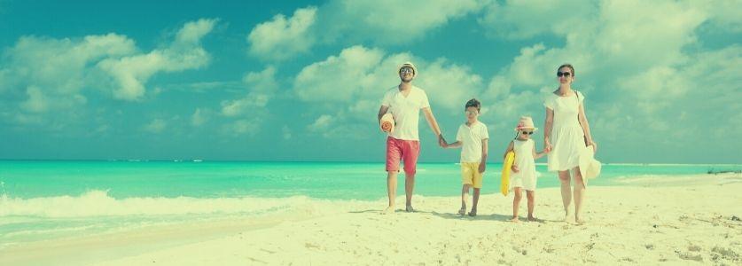 vintage photo of family walking on beach