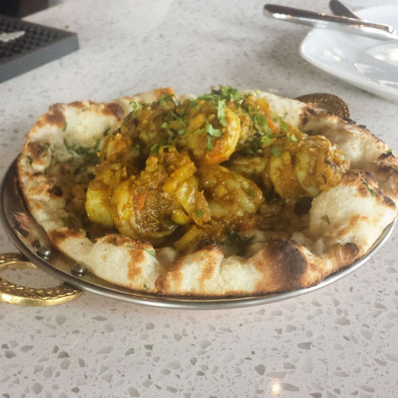 Nawab Restaurant food containing Prawn Goa Masala (spicy jumbo prawns cooked in a tomato and onion masala, served on a garlic naan)