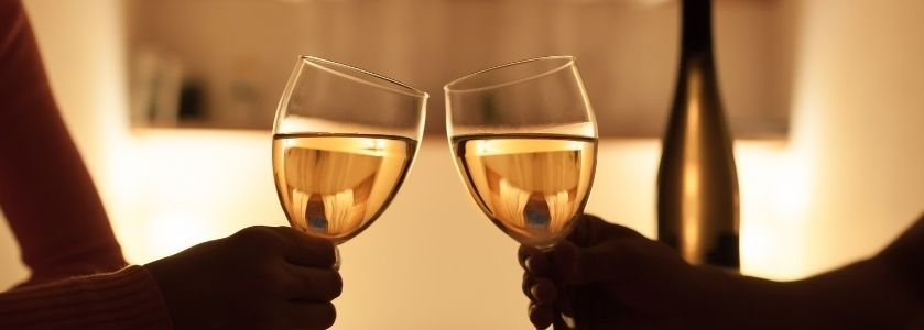 clanging chardonnay glasses on date night
