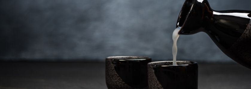 sake poured into black cup