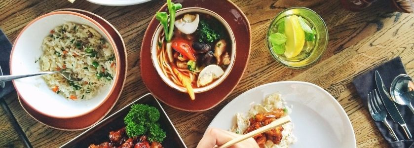 chinese food spread on wooden table