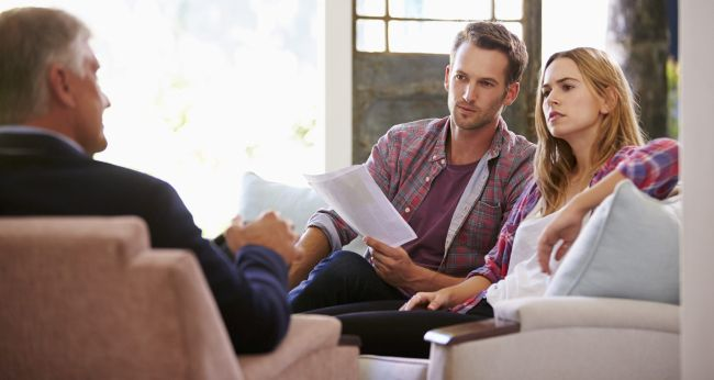 couple in office speaking to lender