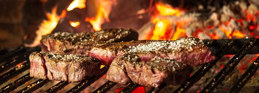 grilled steak tips on open flame