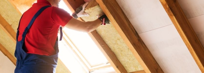 attic insulation being placed by technician