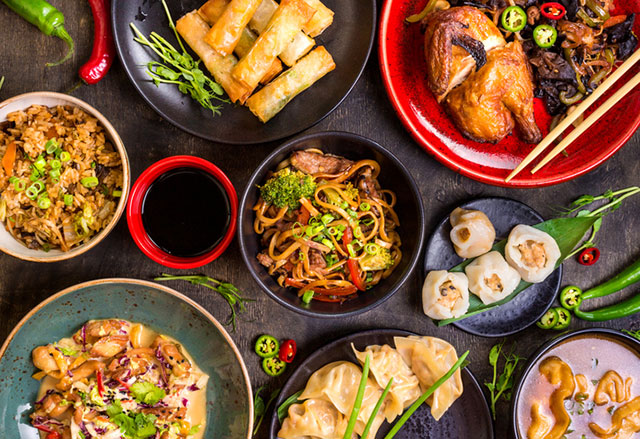 Chinese Food dishes arranged on table