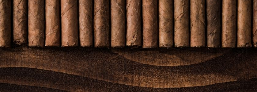 row of hand rolled cigars