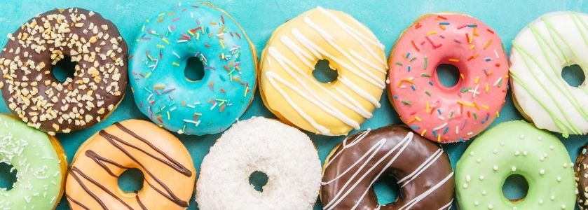 row of donuts on turquoise background