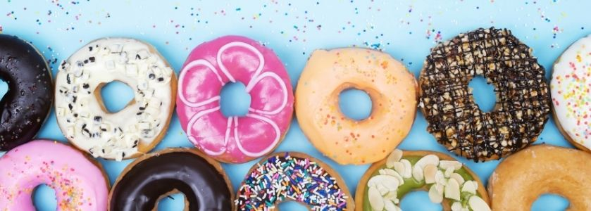 row of donuts on sparkled background