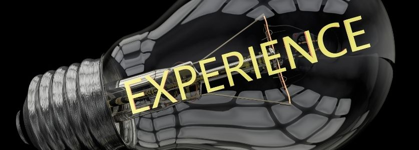 """lightbulb image with """"experience"""" written inside with gold text"""