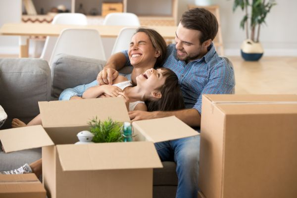 first time home buyers smiling and laughing in new home