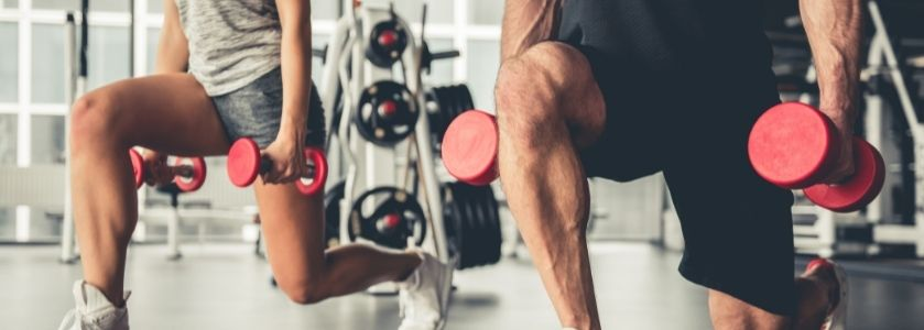 dumbbell lunges in gym