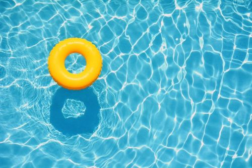 yellow inner tube floating on clear water