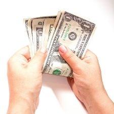 hands counting dollar bills