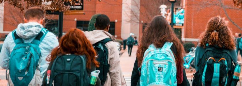 public school students walking up to school