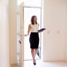 female realtor strolling through front door