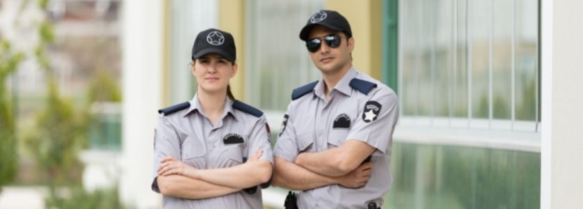 male and female uniformed security guards