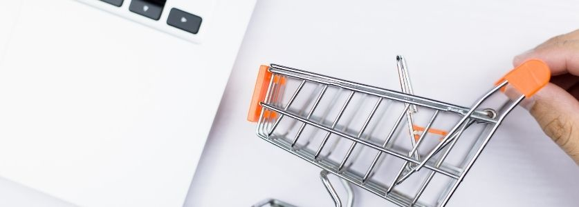 mini shopping cart on laptop