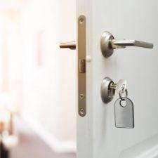 home door open with keys in the handle
