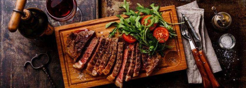 steak on wood fire slab
