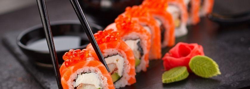 chopsticks grabbing sushi