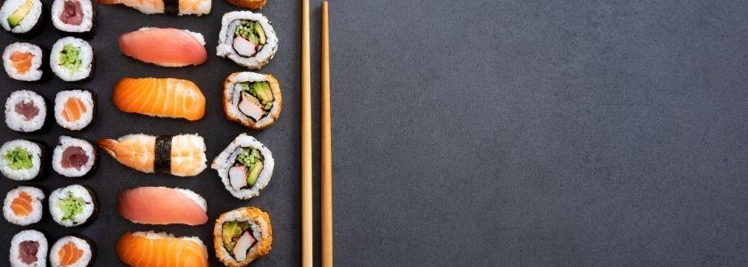 sushi arranged on slab table