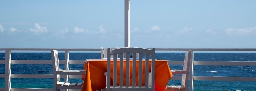 beautiful waterfront dining with orange tablecloth