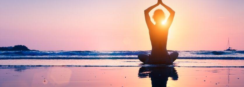 yoga pose on sunny beach